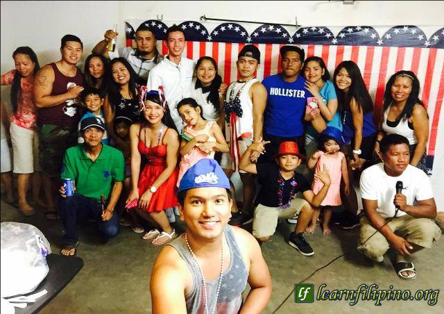 Filipinos from Delano, California – Filipinos love to have FUN! They are good of holding big parties, preparing foods and Karaoke. SELFIE shots are always a part of good parties :) – Photo by Justin Carinio Julian