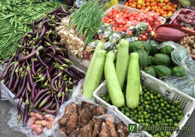Common vegetables you will see in the Philippine Market. Eggplants, calamansi, papaya, spring onion, gourd, okra, bitter melon, banana flower and some root crops. Usually these type of vegetables are locally produced all throughout the Philippines. - Photo by Imelin Cruz Cristobal